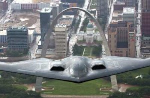 The Stealth Bomber - based in Missouri - flies over the Gateway Arch.